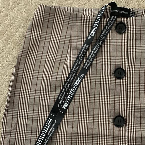 1dd32f811df8 PLT 'Brown Check Button Up High Waisted Skirt'. NWT. PrettyLittleThing.  M_5c745695f63eea13395999d4. M_5c74552dfe5151dee9432910.  M_5c74553045c8b34658f37a11